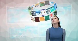 Immagine composita di Digital della donna che esamina le varie pagine Web Immagine Stock Libera da Diritti