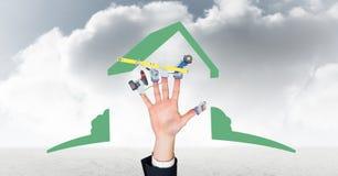 Immagine composita di Digital della mano con gli strumenti contro il cielo nuvoloso Immagini Stock Libere da Diritti