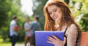 Immagine composita di Digital di varie equazioni di per la matematica con lo studente di college femminile che per mezzo della co Fotografie Stock Libere da Diritti