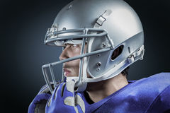 Immagine composita di distogliere lo sguardo d'uso del casco dello sportivo immagine stock libera da diritti