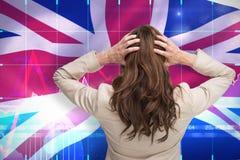 Immagine composita di giovane donna di affari di classe con le mani sulla testa che sta di nuovo alla macchina fotografica Fotografie Stock
