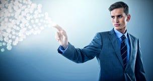 Immagine composita di giovane uomo d'affari ben vestito che gesturing 3d Fotografia Stock Libera da Diritti