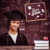 Immagine composita di laurea sveglia dell'allievo Immagine Stock Libera da Diritti