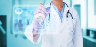 Immagine composita di medico che indica la penna 3d del feltro Fotografie Stock