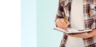 Immagine composita di metà di sezione di scrittura dei pantaloni a vita bassa con la matita sopra Immagine Stock Libera da Diritti