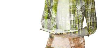 Immagine composita di metà di sezione di scrittura dei pantaloni a vita bassa con la matita sopra Fotografia Stock Libera da Diritti