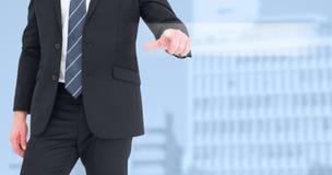 Immagine composita di metà di uomo d'affari della sezione che indica con il suo dito immagine stock libera da diritti