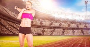 Immagine composita di musica d'allungamento e d'ascolto dell'atleta femminile Fotografia Stock