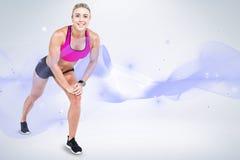 Immagine composita di musica d'allungamento e d'ascolto dell'atleta femminile Fotografia Stock Libera da Diritti