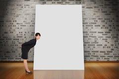 Immagine composita di piegamento serio della donna di affari Fotografia Stock Libera da Diritti