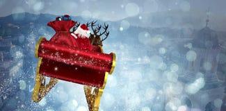 Immagine composita di Santa che pilota la sua slitta fotografia stock