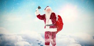 Immagine composita di Santa che suona la sua campana Immagini Stock