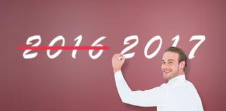 Immagine composita di scrittura allegra dell'uomo d'affari con l'indicatore fotografie stock libere da diritti