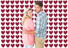 Immagine composita di tornitura attraente e di sorridere delle coppie alla macchina fotografica Fotografia Stock