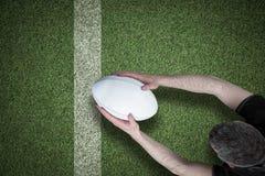 Immagine composita di un giocatore di rugby che segna una prova Fotografia Stock Libera da Diritti