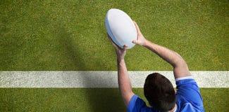 Immagine composita di un giocatore di rugby che segna una prova Immagine Stock Libera da Diritti