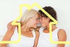 Immagine composita nelle coppie di amore che se esaminano Fotografia Stock