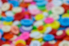 Immagine confusa del clasper di cucito variopinto dei bottoni Immagini Stock Libere da Diritti