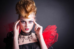 Immagine creativa del sangue e di trucco della regina diabolica Immagini Stock