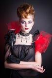 Immagine creativa del sangue e di trucco della regina diabolica Immagine Stock