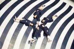 Immagine creativa di graduazione del gruppo asiatico Fotografie Stock Libere da Diritti