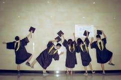 Immagine creativa 2 di graduazione del gruppo asiatico Immagine Stock Libera da Diritti