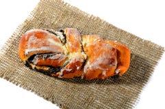 Immagine dei panini freschi con i semi e la glassa di papavero Fotografia Stock