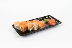 Immagine dei sushi saporiti messi con il salmone Fotografia Stock
