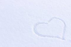 Immagine del cuore sulla neve Immagini Stock
