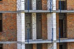 Immagine del dettaglio di nuovo apartement che costruisce in costruzione Immagine Stock
