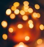Immagine del fondo vago con le luci variopinte calde, tono d'annata del bokeh fotografia stock