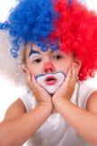 Immagine del primo piano di piccolo ragazzo sveglio del pagliaccio Immagini Stock