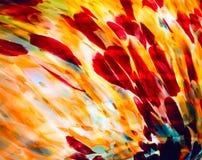 Immagine del primo piano di vetro macchiato colorato nella gamma gialla rossa Fotografia Stock