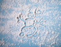 Immagine del pupazzo di neve sulla tavola Fotografie Stock