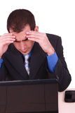 Immagine dell'uomo d'affari che tocca la sua testa immagini stock libere da diritti