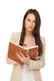 Immagine della donna di affari con il taccuino e della penna isolata su bianco Immagini Stock Libere da Diritti