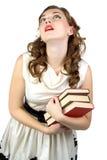 Immagine della donna di sogno con i libri Fotografia Stock