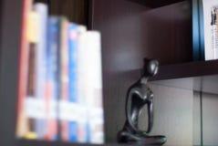 Immagine delle biblioteche della sfuocatura di Buddha fotografie stock libere da diritti