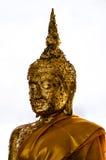 Immagine di Buddha con fede con la foglia di oro Fotografia Stock