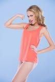 Immagine di parodia di una donna che flette i suoi muscoli Fotografia Stock Libera da Diritti