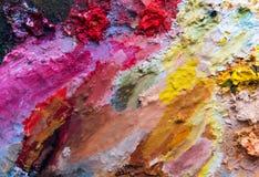 Immagine di sfondo del primo piano luminoso della tavolozza della petrolio-pittura fotografia stock