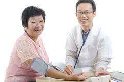 Immagine di un medico e del suo infermiere Fotografia Stock Libera da Diritti