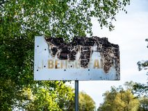 Immagine di vecchia fine bruciata del segno su fotografia stock libera da diritti