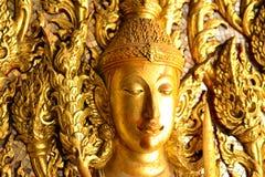 Immagine dorata di Buddha sulla porta Fotografia Stock Libera da Diritti
