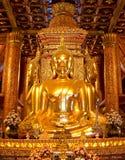 Immagine dorata di quattro Buddha in corridoio principale di Wat Phumin o del tempio minimo di Phu alla provincia di Nan, NorthTh Immagine Stock Libera da Diritti