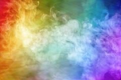 Immagine fantastica astratta con il fumo colorato celeste dell'arcobaleno e della luce immagini stock