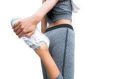 Immagine isolata della donna che fa allungamento della gamba Fotografia Stock