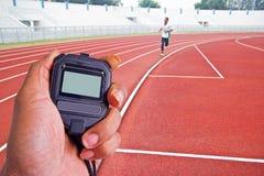 Immagine potata del corridore su funzionamento competitivo Fotografia Stock
