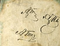 immagine senza cuciture di vecchio foglio di carta ingiallito con i punti scuri e un facsimile dell'iscrizione Fotografie Stock Libere da Diritti