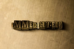 IMMEDIATELY - close-up of grungy vintage typeset word on metal backdrop Royalty Free Stock Photo